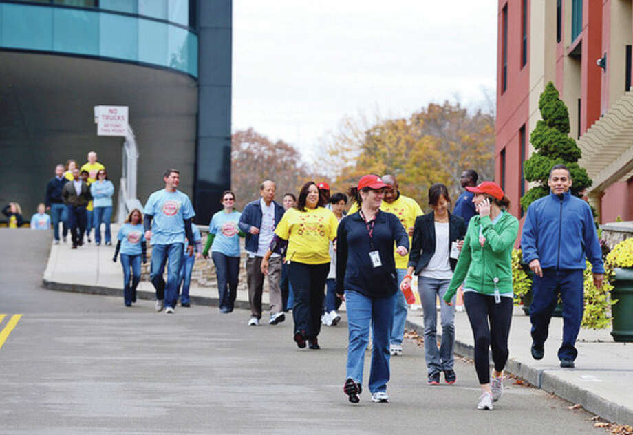 Nearly a hundred Diageo employees walked to raise money for the American Diabetes Association.Hour photo / Erik Trautmann / (C)2012, The Hour Newspapers, all rights reserved