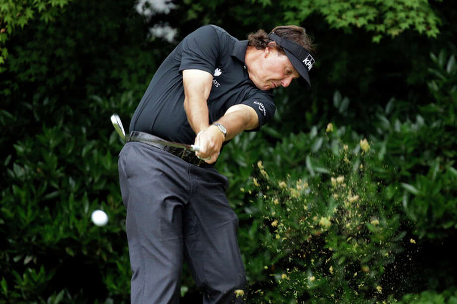 Phil Mickelson tees off on the 11th hole during the first round of the U.S. Open golf tournament at Merion Golf Club, Thursday, June 13, 2013, in Ardmore, Pa. (AP Photo/Morry Gash) / AP