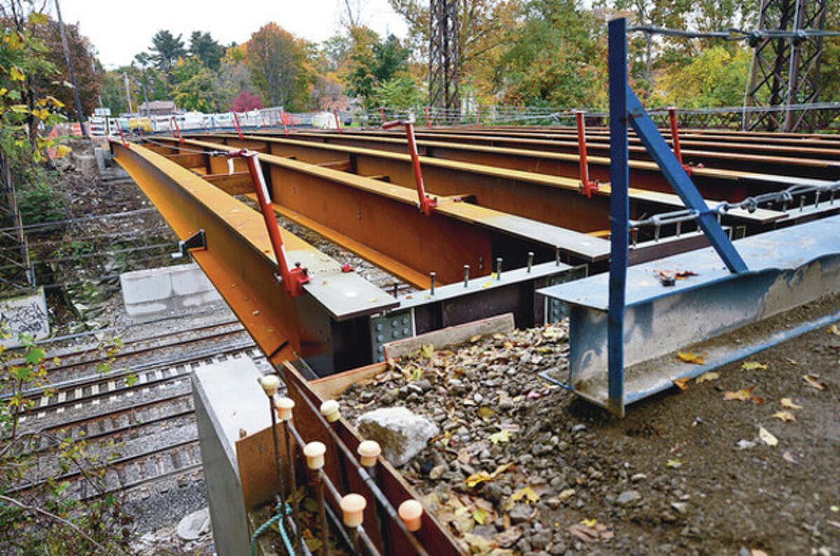 Reconstruction of the Triangle Street Bridge is running at least a month behind schedule. State Department of Transportation cites engineering problems related to Metro-North Railroad catenary lines. Hour photo / Erik Trautmann