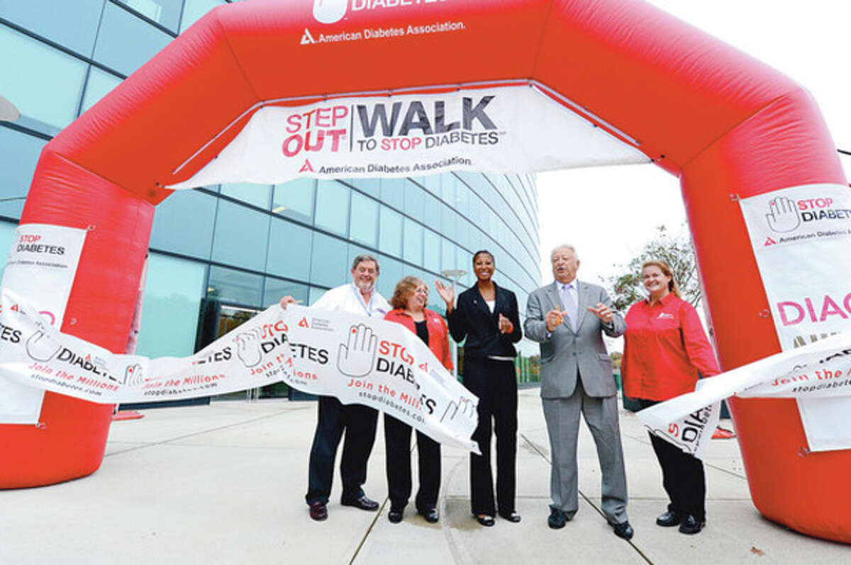 Diageo Executive Vice President of Coporate Relations, Guy Smith, American Diabetes Association Director of Corporate Development, Geri Brown, Diageo Diversity Project Manager, Simone Morris, Mayor Richard Moccia and ADA Fundraising Manager Andrea Dunnam cut the ribbon to lead nearly a hundred Diageo employees on a walk to raise money for the American Diabetes Association. Hour photo / Erik Trautmann