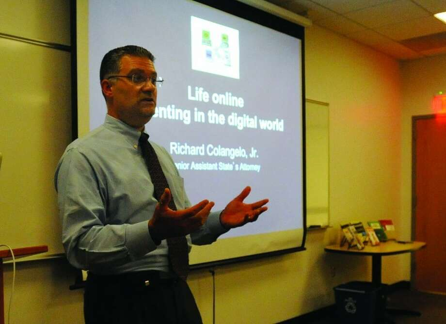 Senior Assistant State's Attorney Richard Colangelo speaks Tuesday at the Wilton Library at the Internet Safety Seminar for parents of young children.
