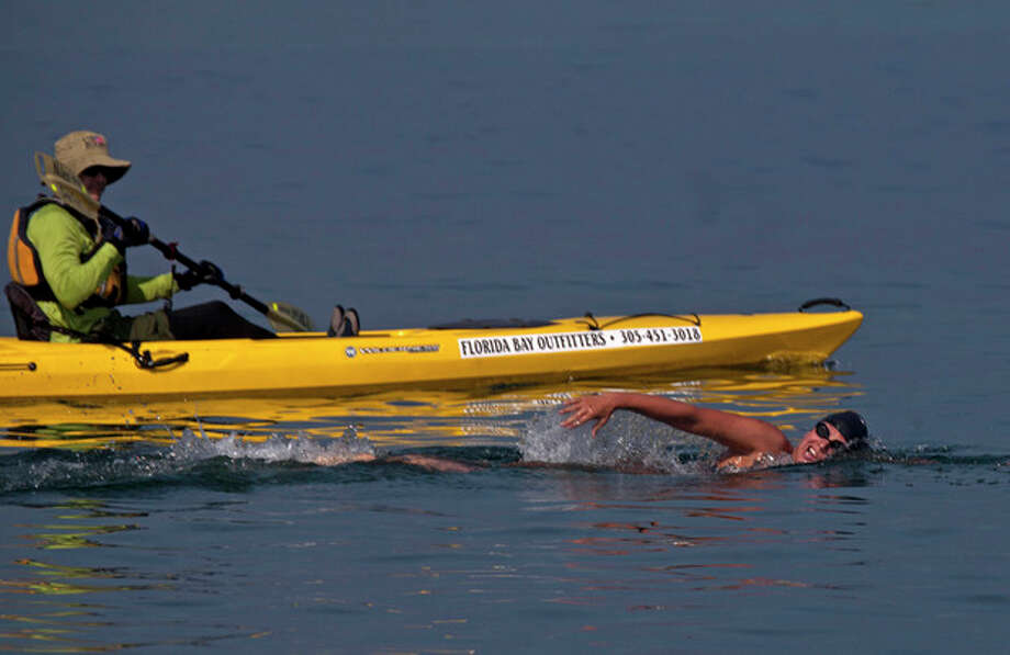 Australian swimmer Chloe McCardel starts her swim to Florida from Havana, Cuba, Wednesday, June 12, 2013. McCardel says she expects to spend about 60 hours in the sea before reaching the Florida Keys, a little more than 100 miles to the northeast. McCardel jumped into the water at Havana's Hemingway Marina on Wednesday morning, accompanied by kayakers and a support boat. (AP Photo/Ramon Espinosa) / AP