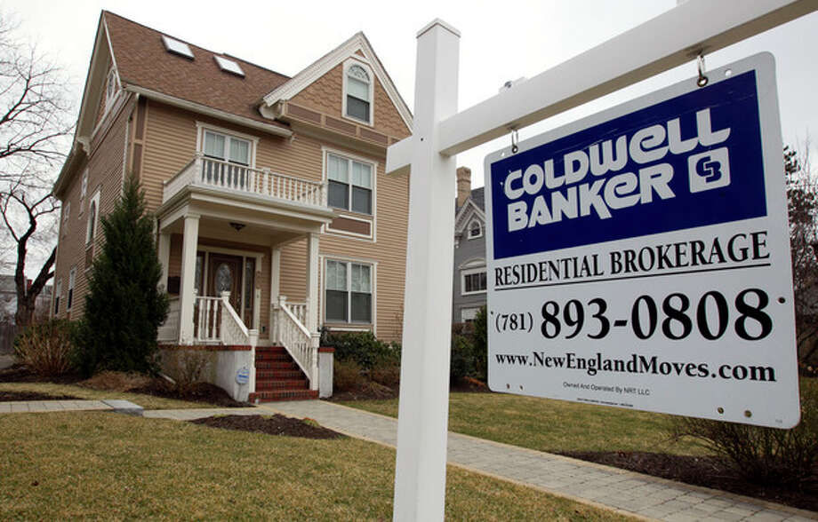 FILE - This March 15, 2012 file photo shows a home with a real estate sign in front in Watertown, Mass. Freddie Mac reports on mortgage rates for this week Thursday June 13, 2013. (AP Photo/Steven Senne, File) / AP