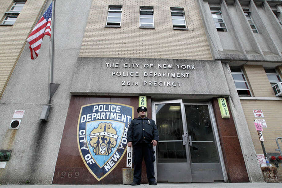 A police officer stands guard outside the 26th precinct where police officer Gilberto Valle worked out of, Thursday, Oct. 25, 2012 in New York. Valle was charged Thursday in a ghoulish plot to kidnap and torture women and then cook and eat their body parts. (AP Photo/Mary Altaffer) / AP