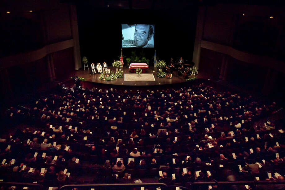 Mourners fill the hall at a funeral service for former Democratic U.S. Senator and three-time presidential candidate George McGovern at the Washington Pavilion of Arts and Science in Sioux Falls, S.D., Friday, Oct. 26, 2012. McGovern died Sunday in his native South Dakota at age 90. (AP Photo/Nati Harnik, Pool) / AP