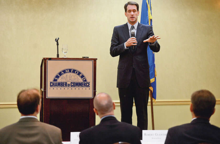 Congressman Jim Himes (D-4) answers questions during a forum sponsored by the Stamford Chamber of Commerce at the Stamford Forum Wednesday.Hour photo / Erik Trautmann / (C)2012, The Hour Newspapers, all rights reserved