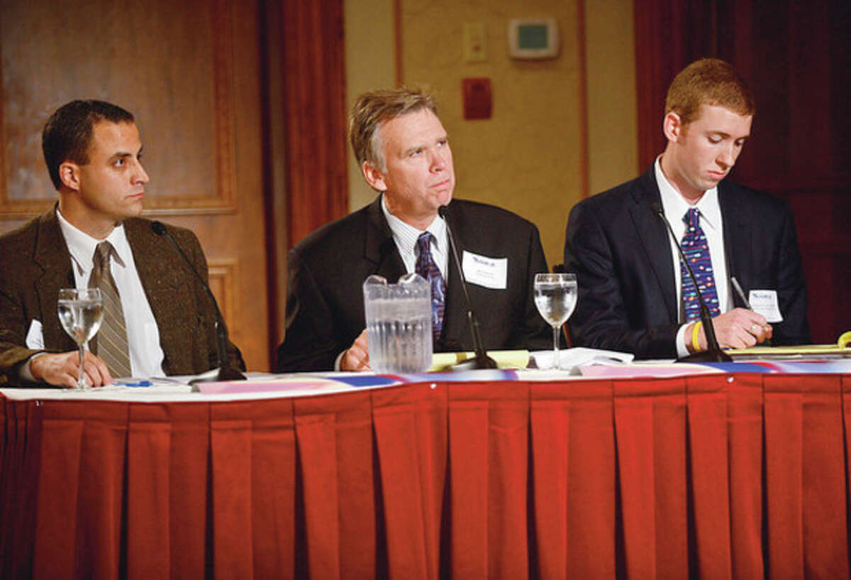 Hour editor, Jerrod Ferrari, Connecticut Post columnist, Ken Dixon, and Patrick Gallagher of the Farifeld County Business Journal ask questions of Congressman Jim Himes and republican challenger Steve Obstinik during their debate at the Norwalk Inn Thursday afternoon. Hour photo / Erik Trautmann
