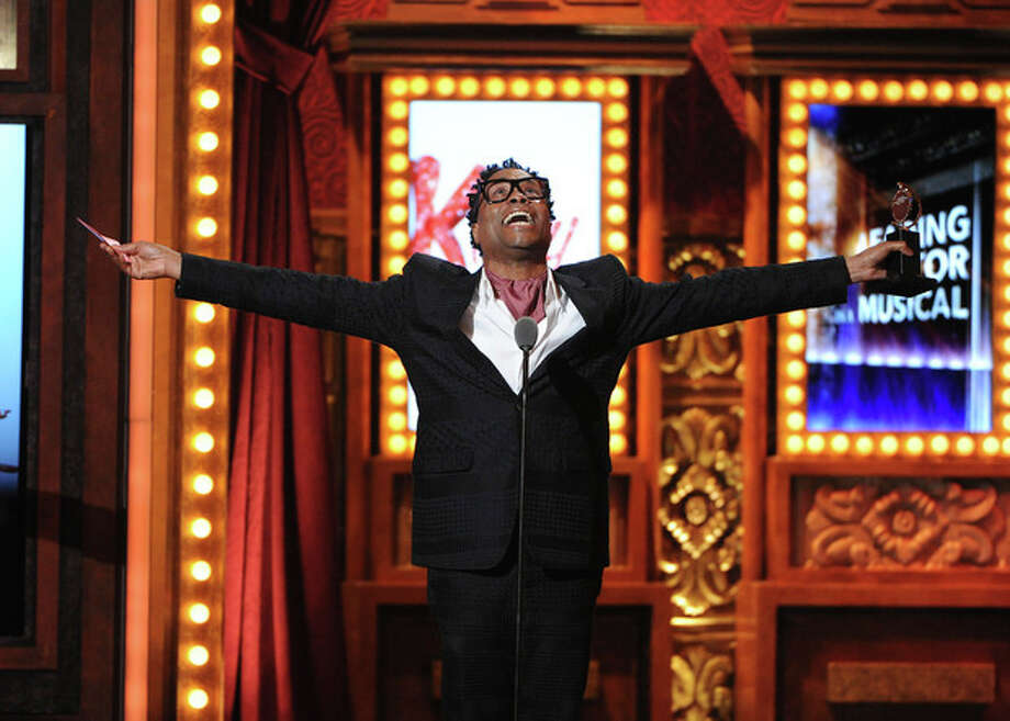 "FILE - This June 9, 2013 file photo shows Billy Porter accepting his award for best actor in a musical for ""Kinky Boots"" at the 67th Annual Tony Awards, in New York. Six alumni from Carnegie Mellon University took home Tonys in five categories, a glittery haul that was both a school record and a huge source of pride for a theater department that turns 100 next year. Billy Porter, Patina Miller and Judith Light each took home acting Tonys, while Ann Roth got one for best costume design, and partners Jules Fisher and Peggy Eisenhauer won for best lighting design of a play. (Photo by Evan Agostini/Invision/AP, file) / Invision"