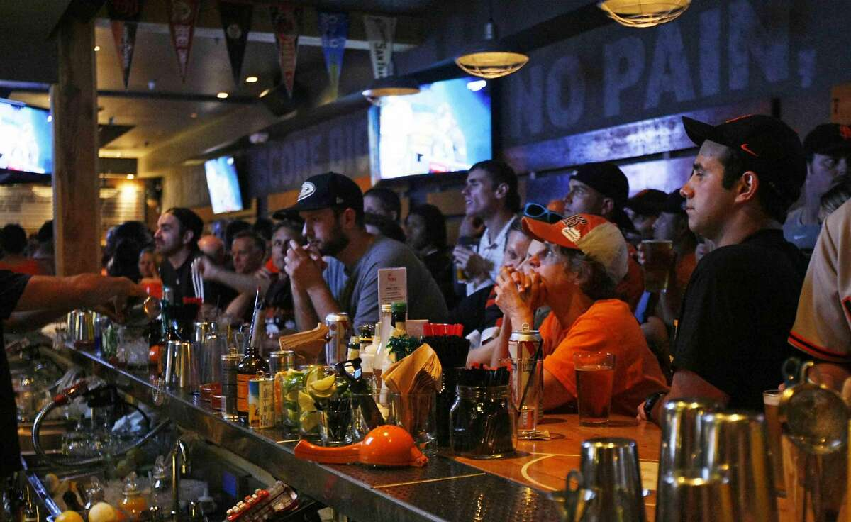 Hundreds of fans packed into Hi Tops bar in the Castro district of San Francisco, Calif. to watch the San Francisco Giants take on the Kansas City Royals in game 7 of the World Series Wednesday, October 29 2014.