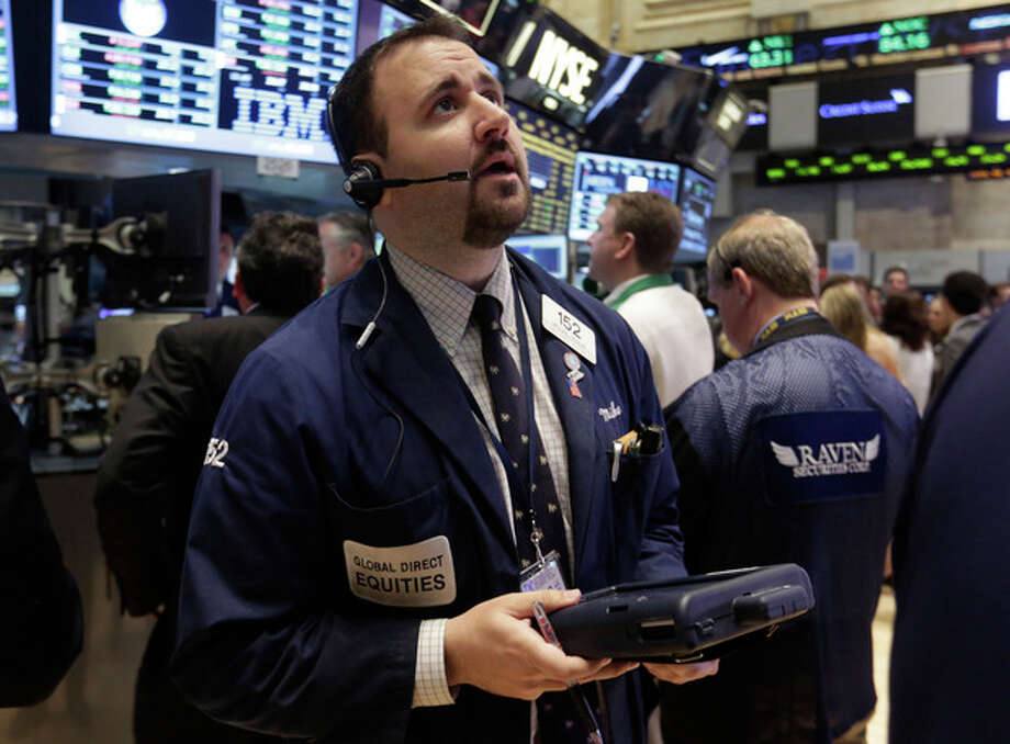 Trader Michael Mozian works on the floor of the New York Stock Exchange Monday, June 10, 2013. Asian stocks rebounded Friday June 14, 2013 from Tokyo's sharp decline after investors were encouraged by positive U.S. economic news. (AP Photo/Richard Drew) / AP