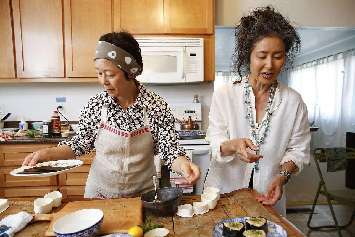 Sonoko Sakai (left) and Robin Koda make onigiri at Koda Farms in South Dos Palos (Merced County).