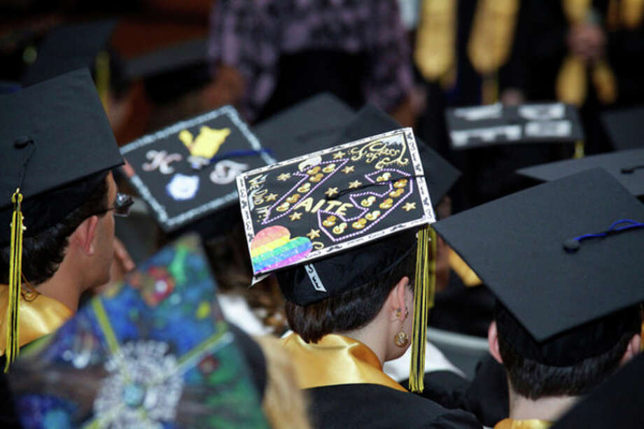 Decorated caps fill the room during AITE's Commencement Exercise at Rippowam Auditorium in Stamford Wednesday evening.Hour Photo / Danielle Calloway