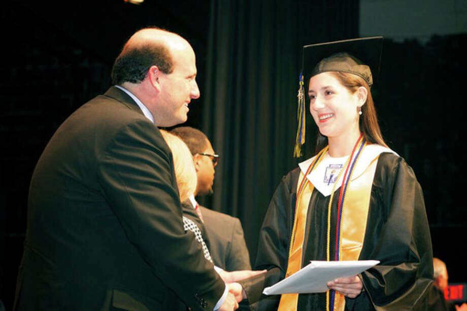 Morgan Cappetta receives her diploma during AITE's Commencement Exercise at Rippowam Auditorium in Stamford Wednesday evening.