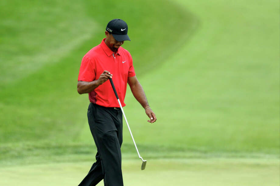 Tiger Woods reacts to a missed putt on the fourth hole during the fourth round of the U.S. Open golf tournament at Merion Golf Club, Sunday, June 16, 2013, in Ardmore, Pa. (AP Photo/Gene J. Puskar) / AP