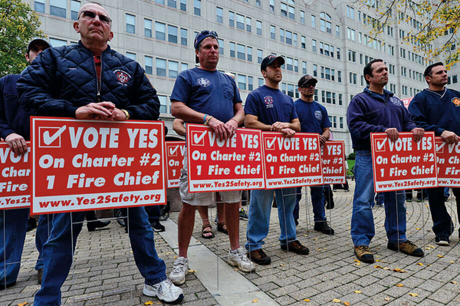 Members of the Stamford Professional Fire Fighters Association rally across the street from Stamford Fire & Rescue Headquarters Saturday in an effort to urge Stamford voters to vote yes for the passage of Charter Question 2 which would create the position of a single chief for the entire city. Hour photo / Erik Trautmann / (C)2012, The Hour Newspapers, all rights reserved