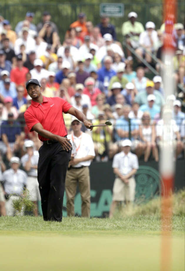 Tiger Woods hits onto the 10th green during the fourth round of the U.S. Open golf tournament at Merion Golf Club, Sunday, June 16, 2013, in Ardmore, Pa. (AP Photo/Gene J. Puskar)