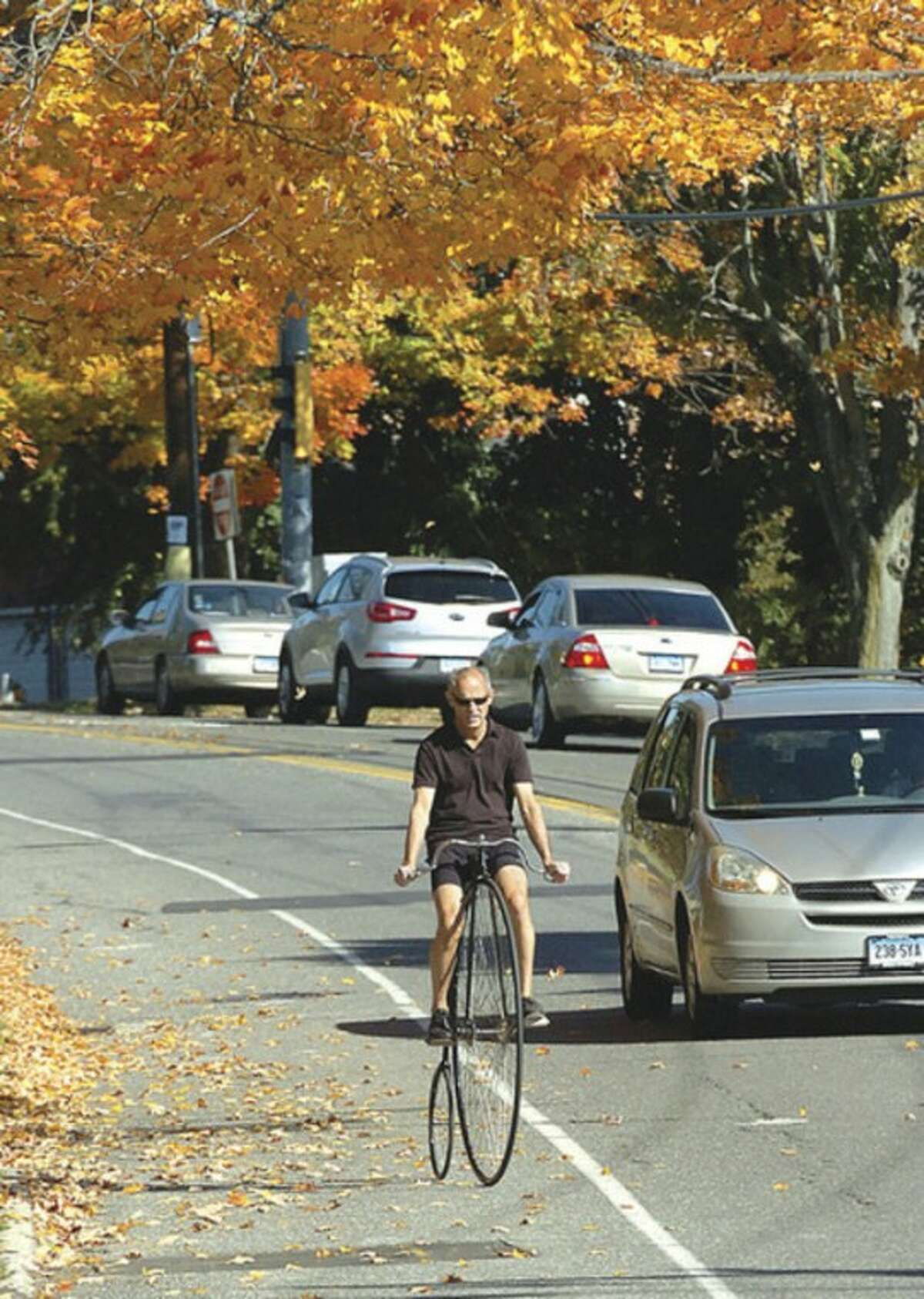 Hour photo / Alex von Kleydorff Norwalk's Jimmy Miller pedals his 1886 Victor Ordinary down Strawberry Hill Avenue. Miller, a vintage bike collector and restorer, rides eight to 10 miles a day in good weather.