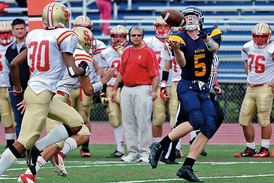 Weston's # 5 Tyler Hassett catches a pass to put Weston in the red zone during their game against Stratford High Saturday. Hour photo / Erik Trautmann / (C)2012, The Hour Newspapers, all rights reserved