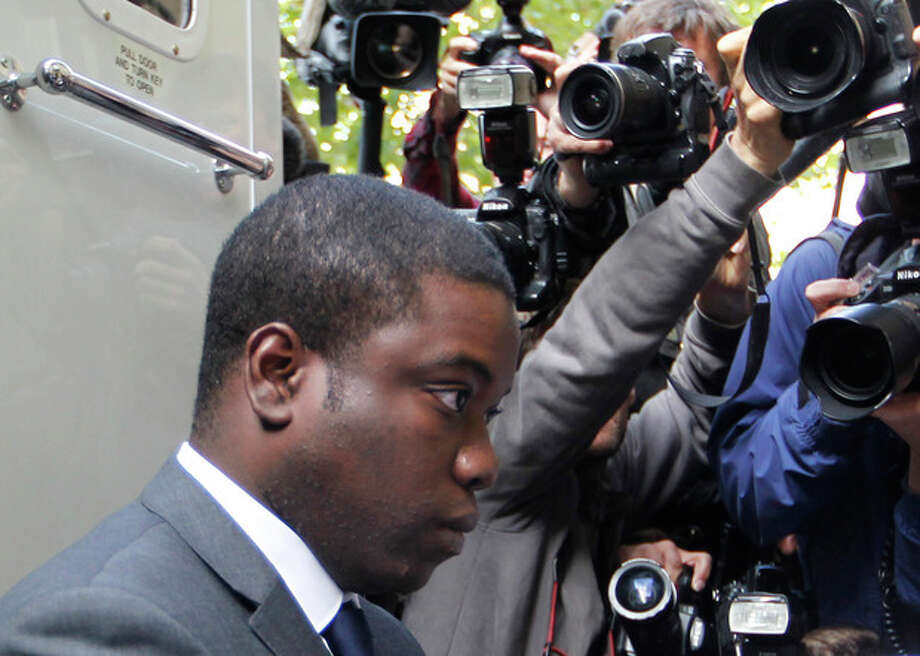 FILE- City trader Kweku Adoboli, arrives at Court in London in this file photo dated Thursday Sept. 22, 2011, where he is accused of fraud and false accounting at Swiss banking giant UBS. Adoboli broke down in tears as he took the stand for the first time Friday Oct. 26, 2012, as he insisted he had acted purely to help save the bank he considered his family. Adoboli has pleaded not guilty to all charges against him. (AP Photo/Sang Tan, File) / AP