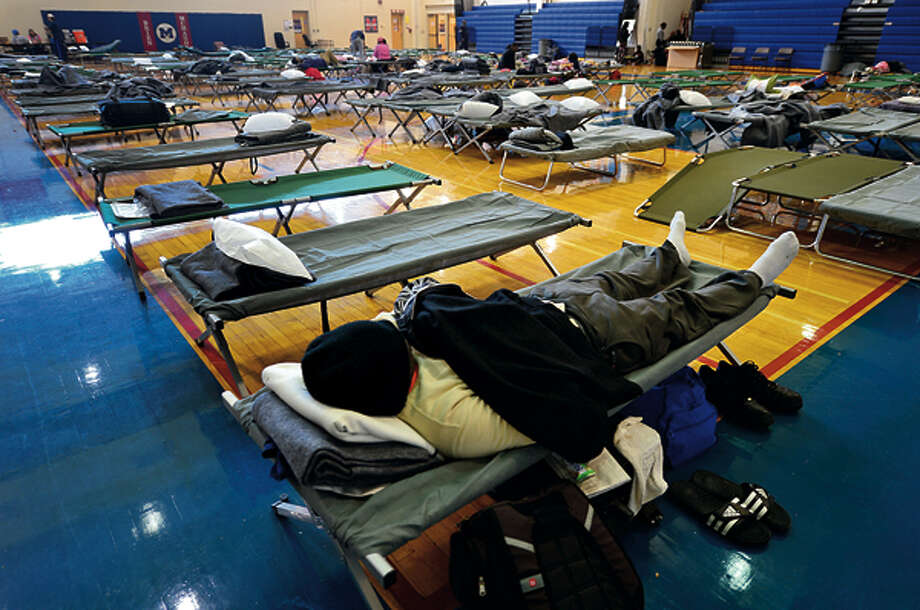 Local residents were able to use Brien Mcmahon High School as shelter during the storm and it's aftermath. Hour photo / Erik Trautmann / (C)2012, The Hour Newspapers, all rights reserved
