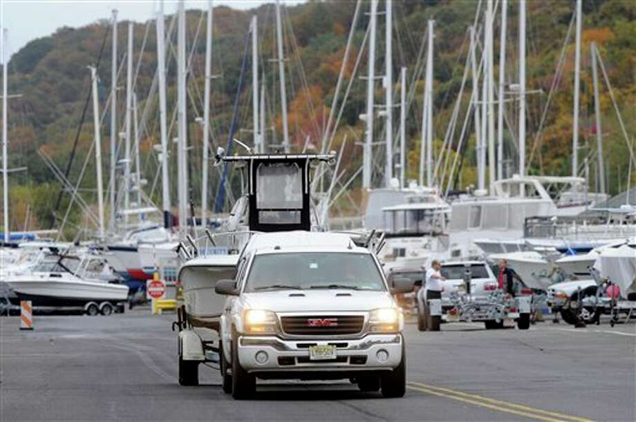 As Hurricane Sandy moves up the East Coast, owners remove their boats from the Atlantic Ocean at the Atlantic Highlands Marina, Friday Oct. 26, 2012 in Atlantic Highlands, N.J. (AP Photo/Joe Epstein) / FR170243 AP