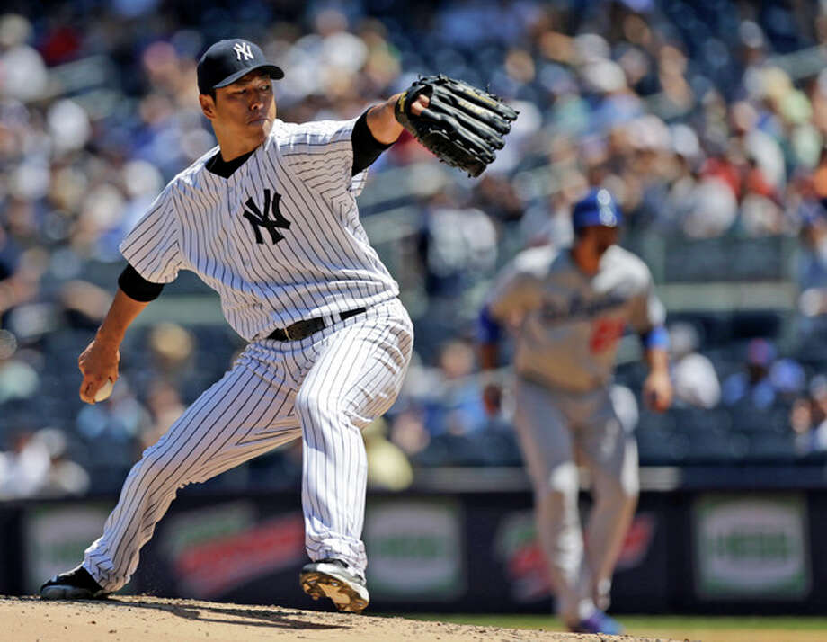 New York Yankees starting pitcher Hiroki Kuroda, of Japan, delivers during the fourth inning of a baseball game against the Los Angeles Dodgers Wednesday, June 19, 2013, in New York. (AP Photo/Kathy Willens) / AP