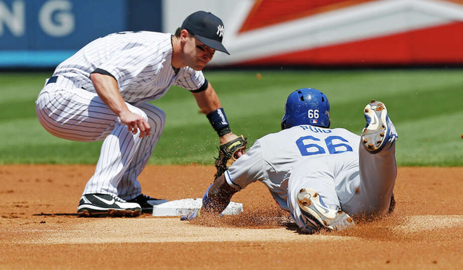 New York Yankees shortstop Jayson Nix catches Los Angeles Dodgers Yasiel Puig (66) stealing in the second inning of a baseball game Wednesday, June 19, 2013, in New York. (AP Photo/Kathy Willens) / AP