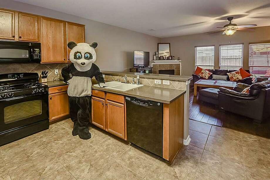 PANDA PAD A Houston real estate agent took her own unique approach to selling this home at 22427 High Point Pines in 2016. She posed in a panda costume in different rooms to draw attention. Photo: Vernon Stamm/Stamm Photography