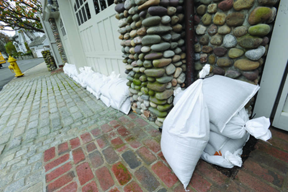 Sand bags protecting properties in the Bell Isalnd area of Rowayton. hour photo/Matthew Vinci / (C)2011 {your name}, all rights reserved