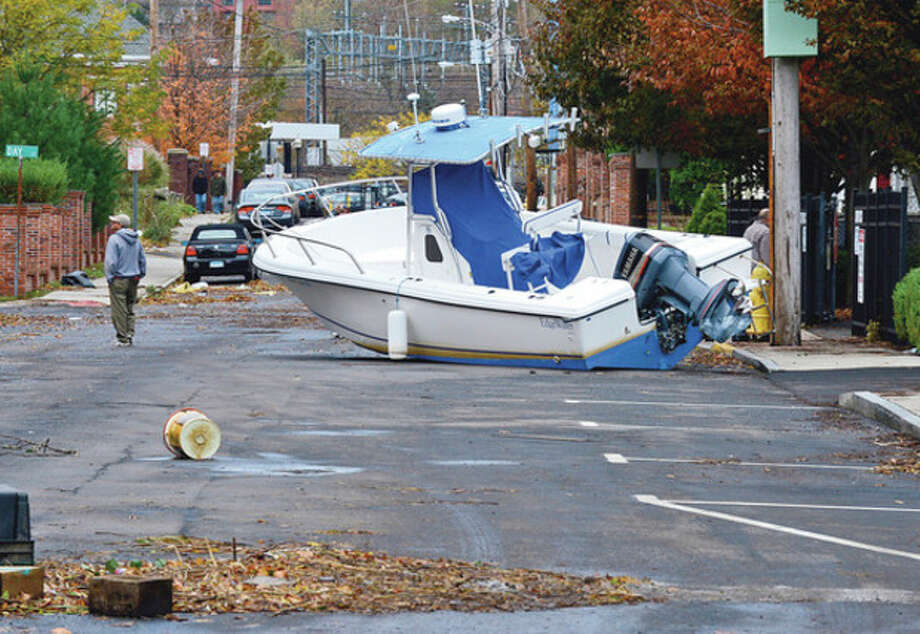 Hour photo / Erik TrautmannNeighborhoods near the waterfront including Water Street in South Norwalk in Norwalk were inundated with storm surge and high winds bringing down trees and blocking streets. / (C)2012, The Hour Newspapers, all rights reserved