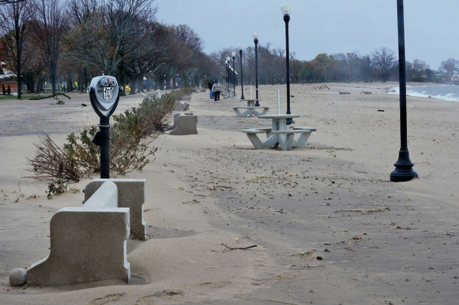 1200 lb concrete benches at Calf Pasture Beach were knocked over during the storm. Neighborhoods near the waterfront in Norwalk were inundated with storm surge and high winds bringing down trees and blocking streets. Hour photo / Erik Trautmann / (C)2012, The Hour Newspapers, all rights reserved