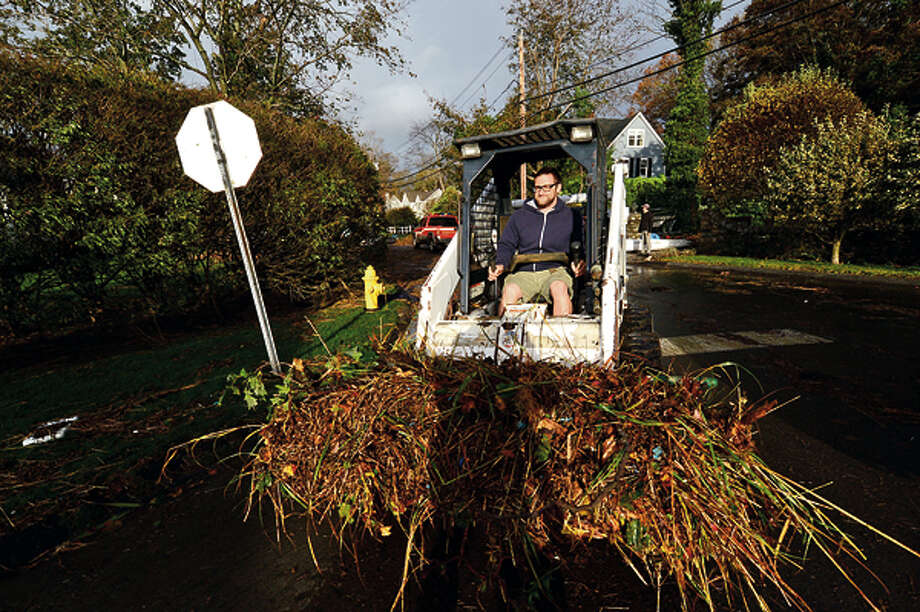 Residents began clean up in Rowayton early Tuesday. Neighborhoods near the waterfront in Norwalk were inundated with storm surge and high winds bringing down trees and blocking streets. Hour photo / Erik Trautmann / (C)2012, The Hour Newspapers, all rights reserved