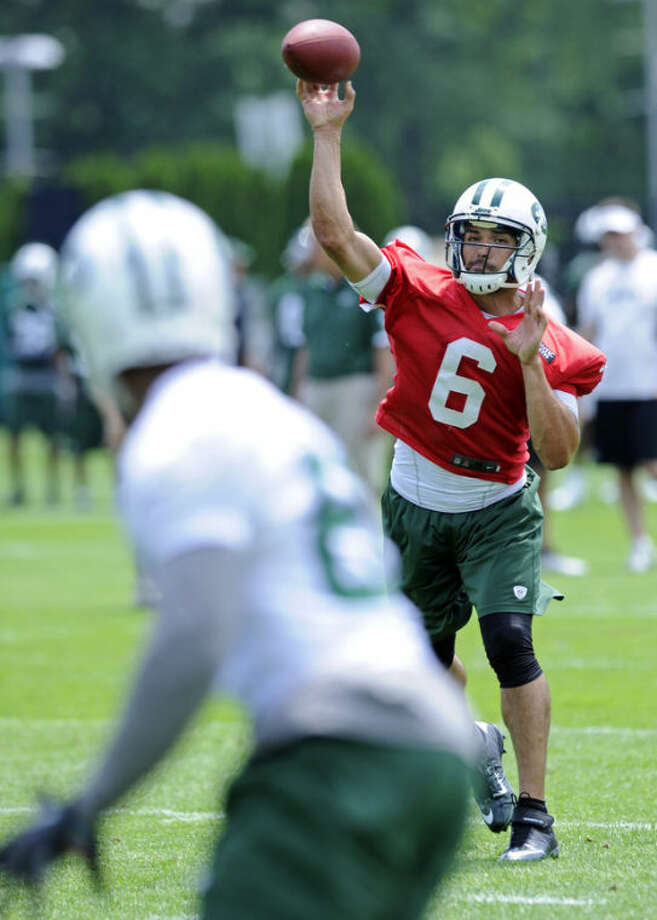 New York Jets quarterback Mark Sanchez throws a pass during NFL football minicamp Tuesday, June 11, 2013, in Florham Park, N.J. (AP Photo/Bill Kostroun)