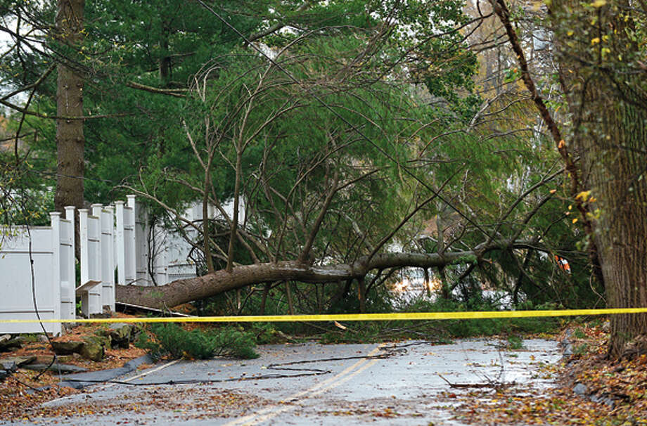 Neighborhoods near the waterfront in Norwalk were inundated with storm surge and high winds bringing down trees and blocking streets. Hour photo / Erik Trautmann / (C)2012, The Hour Newspapers, all rights reserved