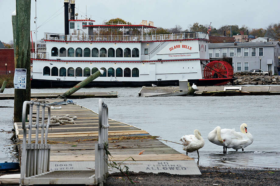 The Island Belle broke loose from it's mooring at the Veteran's Memorial Park Visitor's Monday. Emergencey personnel helped moor it on the other side of Norwalk Harbor but the channel remains impassable. Neighborhoods near the waterfront in Norwalk were inundated with storm surge and high winds bringing down trees and blocking streets. Hour photo / Erik Trautmann / (C)2012, The Hour Newspapers, all rights reserved