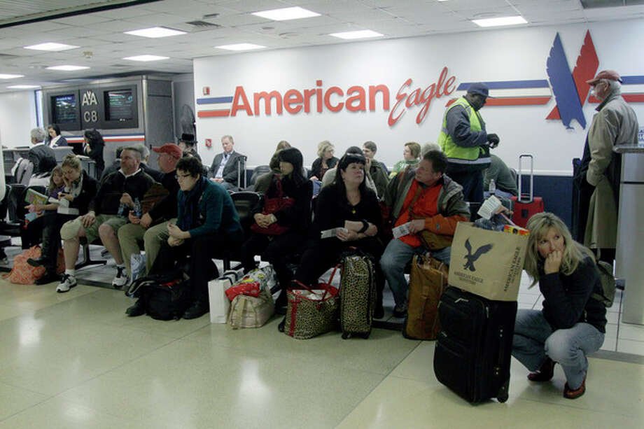 Passengers wait for their flight at at LaGuardia airport, Sunday, Oct. 28, 2012 in New York. Tens of thousands of residents were ordered to evacuate coastal areas Sunday as big cities and small towns across the Northeast buttoned up against the onslaught of a superstorm (AP Photo/Mary Altaffer) / AP