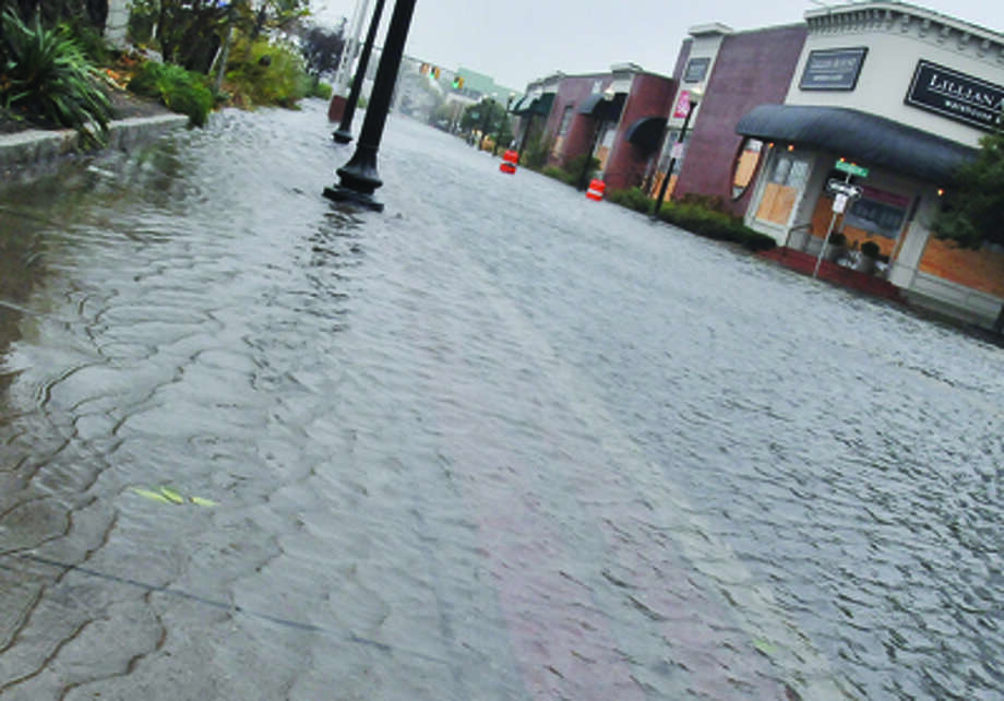 Water street in South Norwalk begins flooding Monday afternoon as hurricane Sandy moves into the area. hour photo/Matthew Vinci / (C)2011 {your name}, all rights reserved
