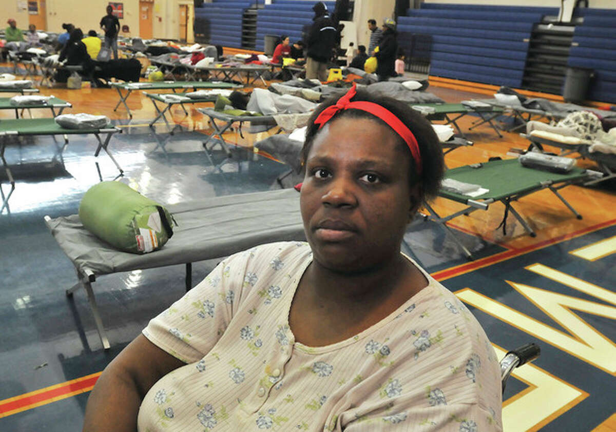 Debrah Jefferson left her Butler street apartment Monday to stay at the Brien McMahon high school gym which is a Red Cross shelter from hurricane Sandy. hour photo/Matthew Vinci