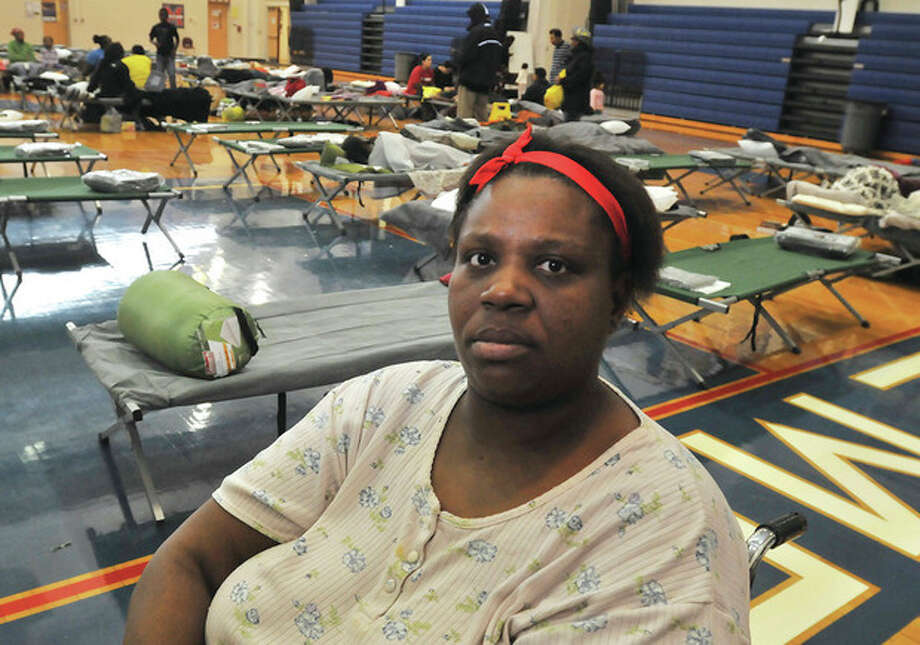 Debrah Jefferson left her Butler street apartment Monday to stay at the Brien McMahon high school gym which is a Red Cross shelter from hurricane Sandy. hour photo/Matthew Vinci / (C)2011 {your name}, all rights reserved