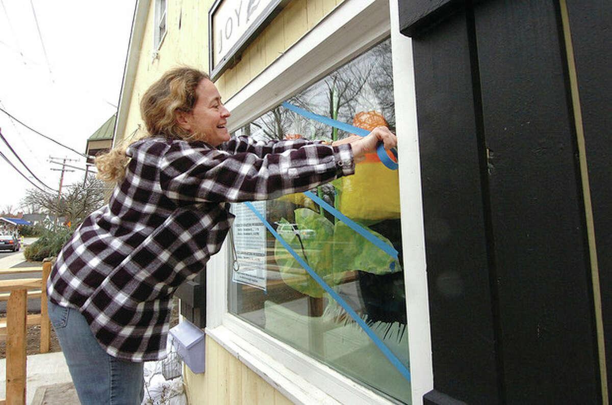 Hour Photo Alex von Kleydorff; Owner Joyce Bottone tapes the windows on her shop Joy 2 Crafts on Riverside Ave Westport