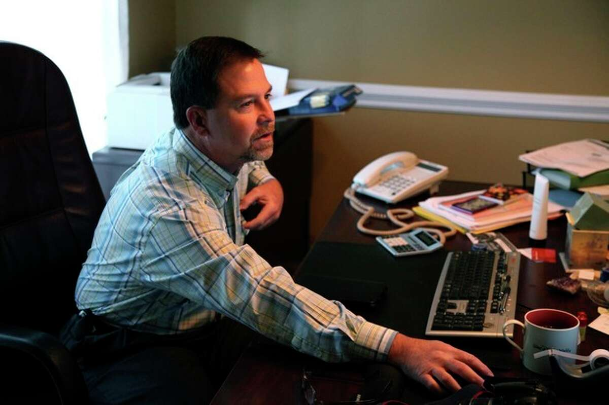In this Oct. 19, 2012, photo, Ray Arvin poses by his work computer, in Charlotte, N.C. Romney supporter, Arvin used to own a small business with five employees, selling equipment to power companies, but he went out of business in 2009. He?'s now a salesman for another equipment company. Polls consistently find that the economy is the top concern of voters, and Romney tends to get an edge over Obama when people are asked who might do better with it. Whether that truly drives how Americans vote is a crucial question for Election Day. (AP Photo/Robert Ray)
