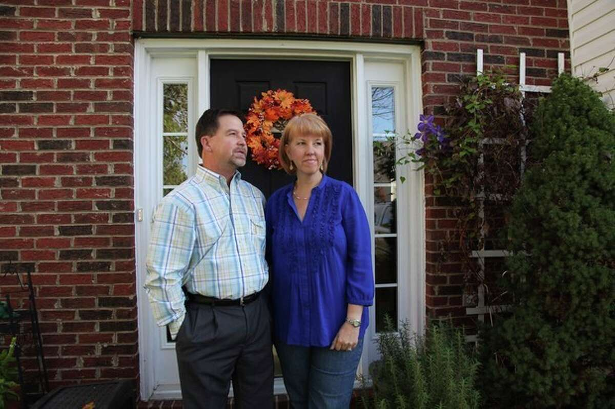 In this Oct. 19, 2012, photo, Ray and Candice Arvin pose outside their home in Charlotte, N.C. Romney supporter, Arvin used to own a small business with five employees, selling equipment to power companies, but he went out of business in 2009. He?'s now a salesman for another equipment company. Polls consistently find that the economy is the top concern of voters, and Romney tends to get an edge over Obama when people are asked who might do better with it. Whether that truly drives how Americans vote is a crucial question for Election Day. (AP Photo/Robert Ray)