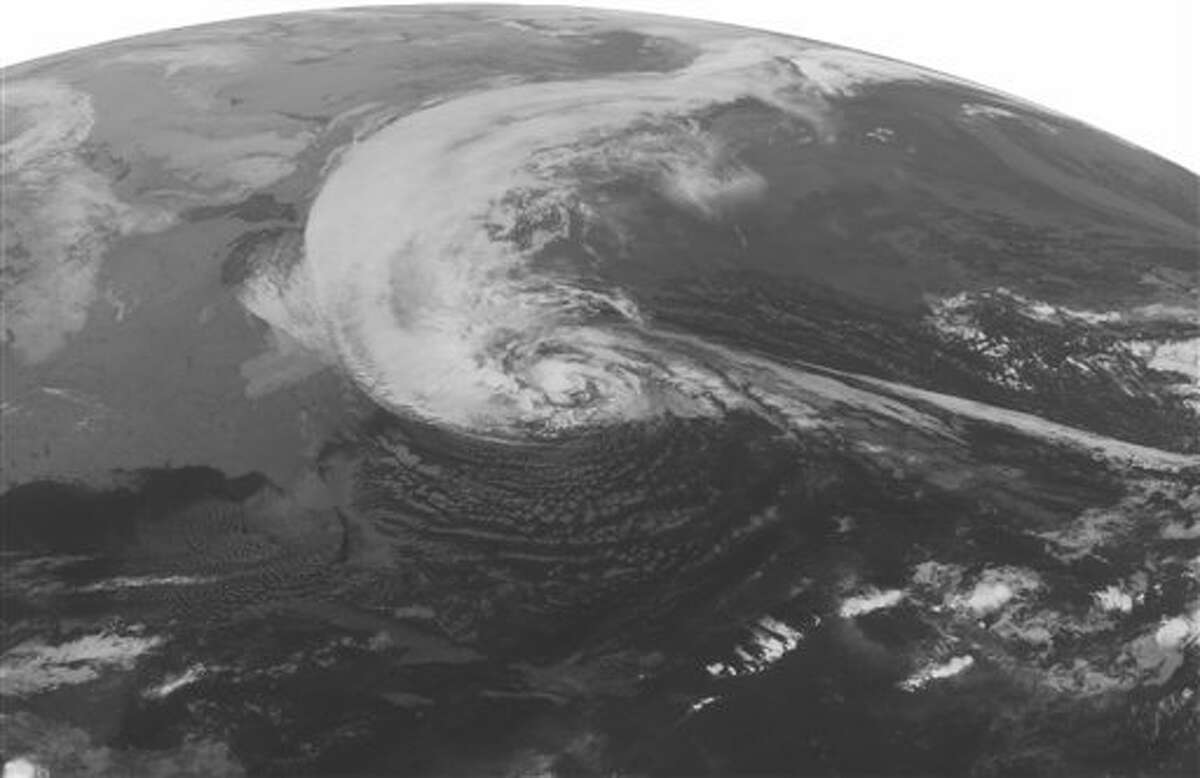 This NOAA satellite image taken Monday, Oct. 29, 2012 at 1:45 a.m. EDT shows Hurricane Sandy turning to the to the north well east of Cape Hatteras, N.C. Maximum winds are 75 mph with slight strengthening possible in the next 12 hours. Sandy is spreading rain and high winds across the Mid Atlantic and New England and is expected to make landfall later today on the southern New Jersey coast. Wind gusts as high as 80 mph can expected from southern New England to the Washington area. Storm surges of 6 to 10 feet are expected in the New York City area, Long Island, and the New Jersey coast. Heavy snow will develop over the mountains of West Virginia, eastern Kentucky, and southwestern Virginia with 1-2 feet expected. (AP Photo/Weather Underground)