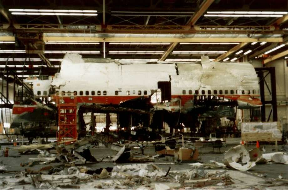"FILE - This photo released by the National Transportation Safety Board in this March 12, 1997 file photo, taken March 6, 1997, shows reconstruction work continuing in Calverton, N.Y., on TWA Flight 800 which crashed into the Atlantic Ocean off New York's Long Island. Former NTSB investigators of the TWA Flight 800 crash off Long Island are calling on the National Transportation Safety Board to re-examine the case. The retired investigators claim that findings were ""falsified."" (AP Photo/NTSB, File)"