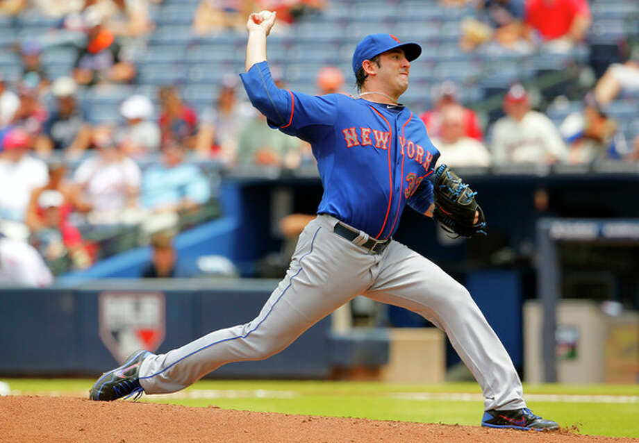 New York Mets starting pitcher Matt Harvey throws in the fourth inning of the first baseball game of a doubleheader against the Atlanta Braves, Tuesday, June 18, 2013, in Atlanta. (AP Photo/Todd Kirkland) / FR170762 AP