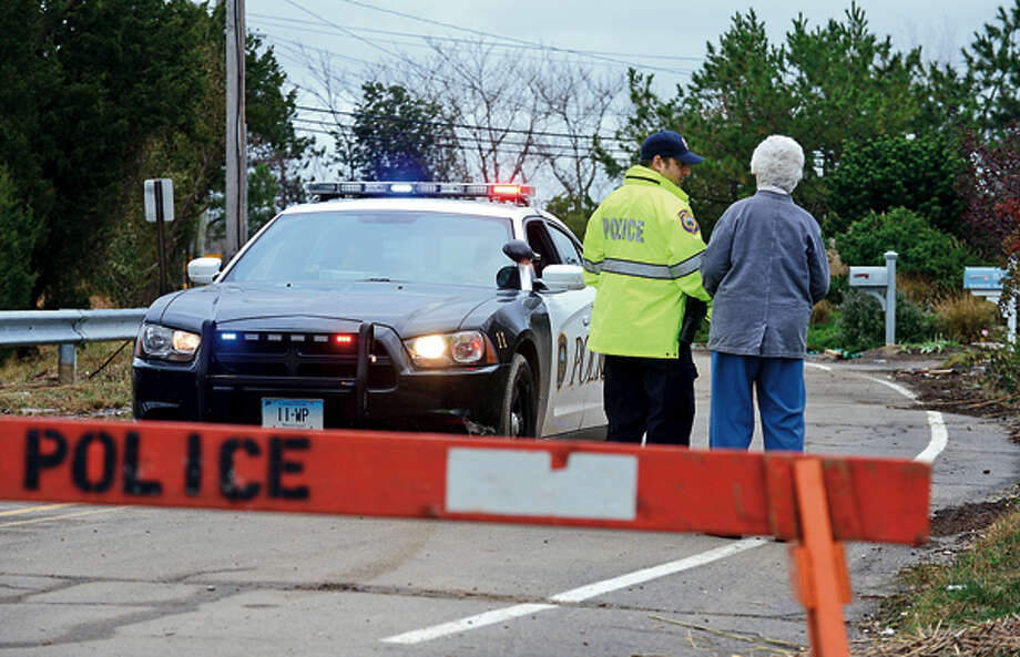 Westport police closed neighborhoods near the waterfront including Saugatuck Shores which were inundated with storm surge. Hour photo / Erik Trautmann / (C)2012, The Hour Newspapers, all rights reserved