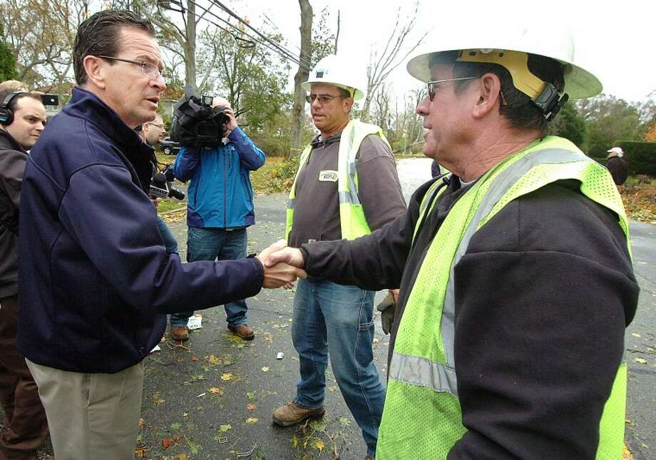 Hour Photo Alex von Kleydorff; In Stamford, Connecticut Governor Dannel Malloy meets a utility crew form Kansas City Power and light from Missouri whie touring the the Shippan area hard hit by Hurricane Sandy