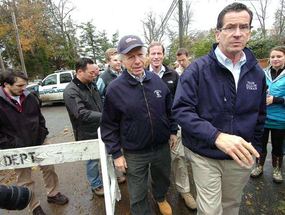 Hour Photo Alex von Kleydorff; Connecticut Governor Dannel Malloy tours hard hit Shippan area of Stamford Ct. after Hurricane Sandy with Sen. Joe Lieberman and Sen. Richard Blumenthal on Monday afternoon.