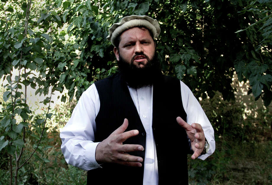 "Shafiullah Nooristani, a member of the Afghan High Peace Council, speaks during an interview with The Associated Press in Kabul, Afghanistan, Wednesday, June 19, 2013. Afghanistan President Hamid Karzai's said Wednesday he will not pursue peace talks with the Taliban unless the United States steps out of the negotiations, while also insisting the militant group stop its violent attacks on the ground after it claimed responsibility for a rocket attack that killed four Americans. Karzai had said Tuesday that he would send representatives from his High Peace Council to Qatar for talks but aides said he changed his mind after objecting to the Taliban's use of its formal name ""Islamic Emirate of Afghanistan"" in opening an office in Doha. (AP Photo/Rahmat Gul) / AP"
