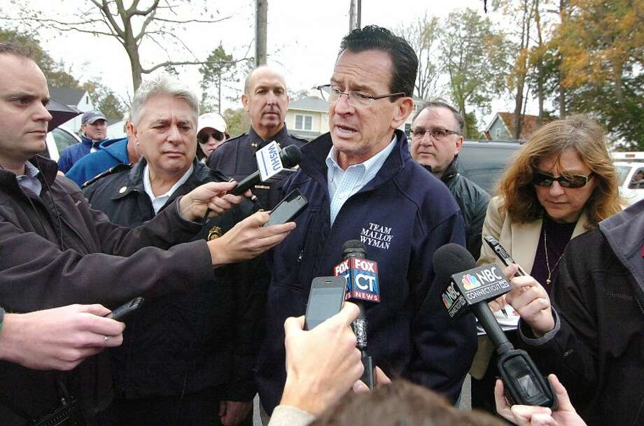 Hour Photo Alex von Kleydorff; Governor Dan Malloy and Stamford Fire and Rescue Chief Tony Conte talk with the media along Shippan Ave on Monday after Hurricane Sandy